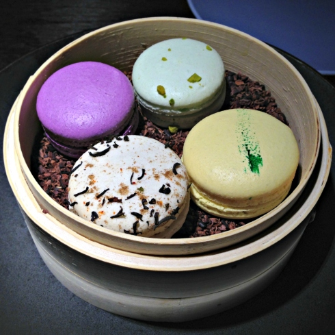chai, cassis, pistachio, and key lime macarons