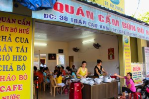 Signs advertising the menu at Quan Cam in Hue