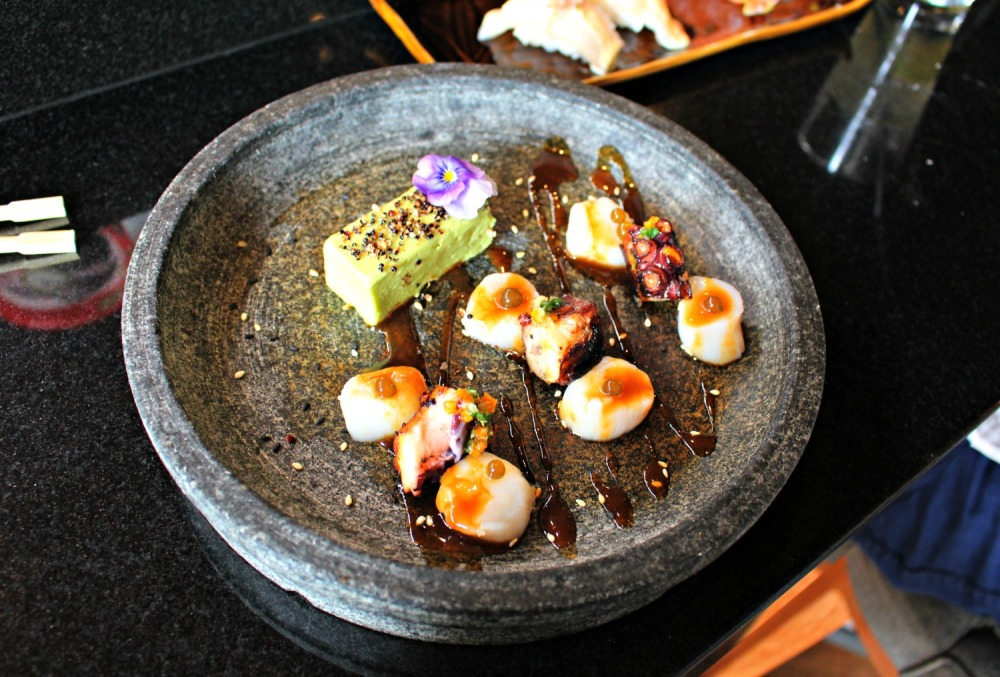 Octopus and scallops topped with algae and avocado mousse
